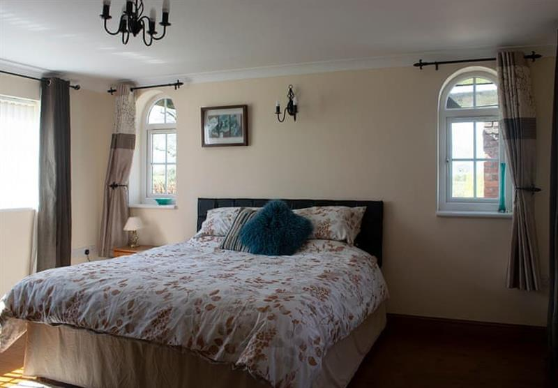 Double bedroom in The Stables Cottage at Camper UK Leisure Park in Swinethorpe, Nr Lincoln