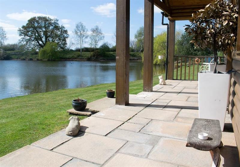 Lakeside Log Cabin veranda at Camper UK Leisure Park in Swinethorpe, Nr Lincoln