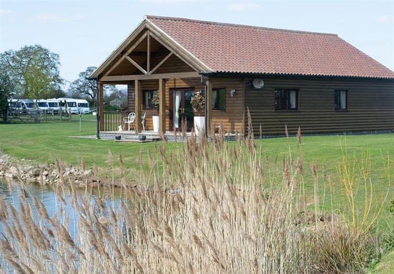 Outside the Lakeside Log Cabin at Camper UK Leisure Park in Swinethorpe, Nr Lincoln