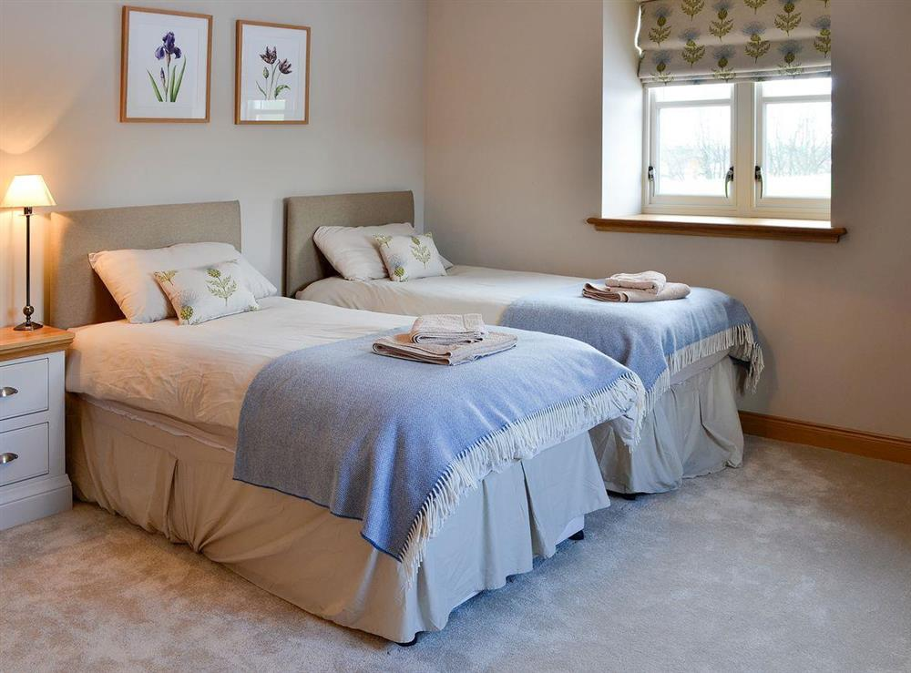 Bright and warm twin bedroom at Canterland Lodge in Marykirk, near Montrose, Aberdeenshire, Scotland