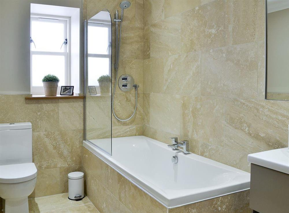 Fully tiled bathroom with shower over the bath at Canterland Lodge in Marykirk, near Montrose, Aberdeenshire, Scotland