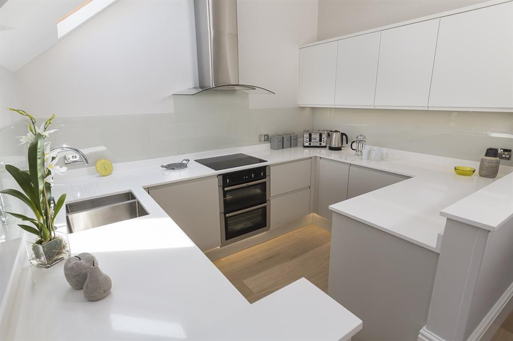 Modern, well equipped kitchen at Carriage Loft Cottage in Hillfield, Dartmouth