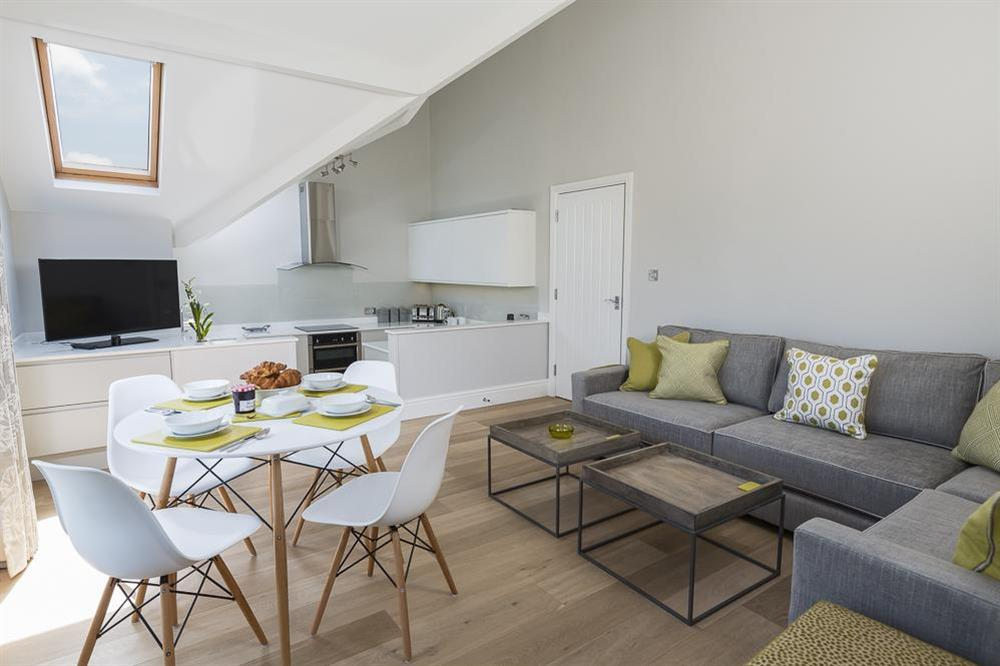 Open plan living, dining and kitchen area at Carriage Loft Cottage in Hillfield, Dartmouth