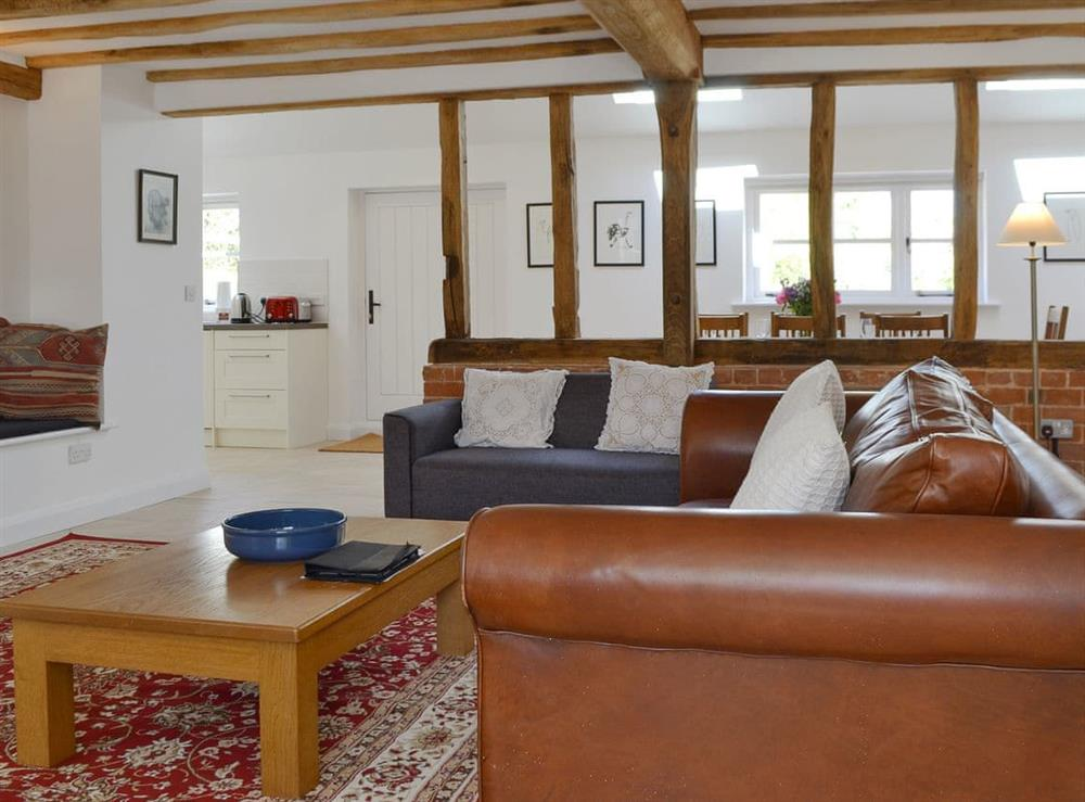 Comfortable living room full of character at The Hop Cottage,