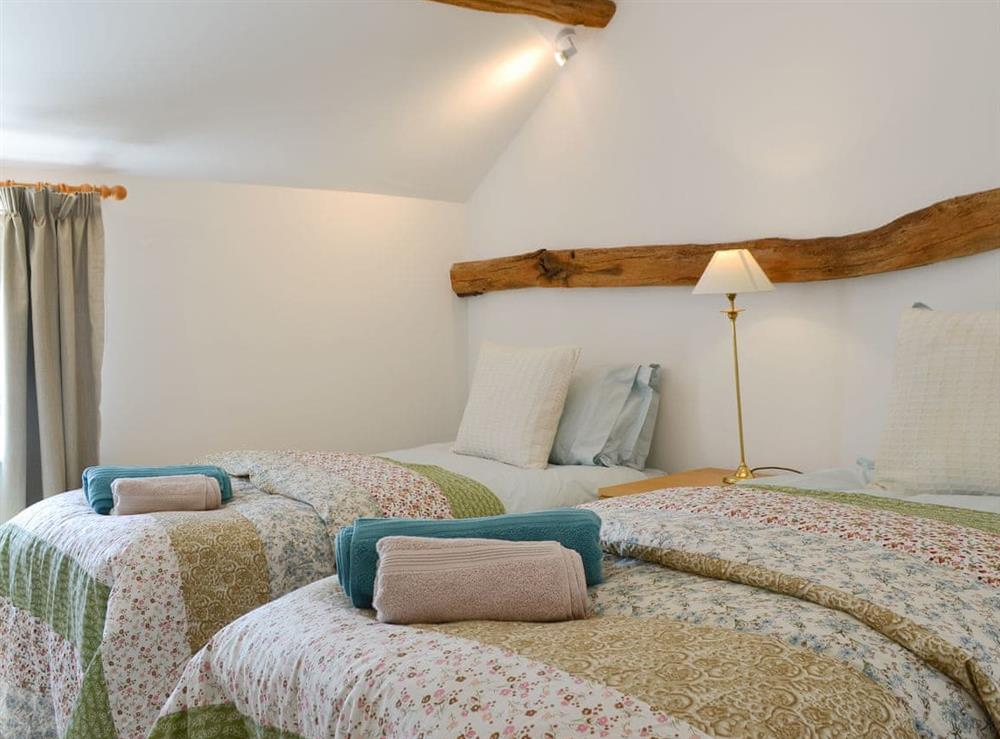 Comfy twin bedroom at The Hop Cottage,