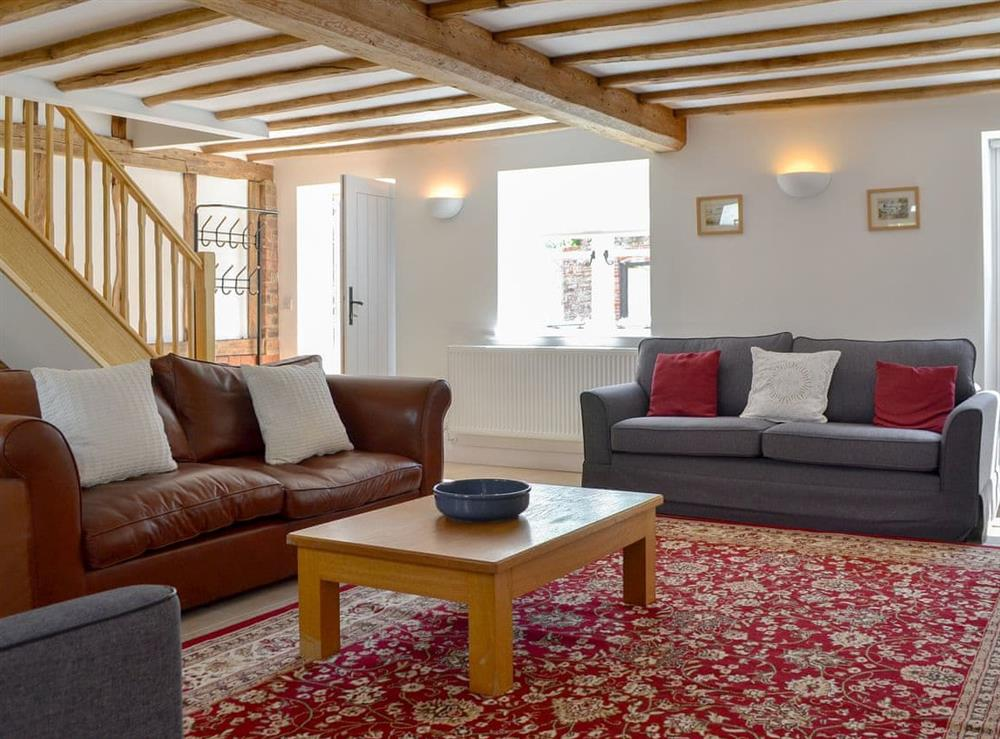 Spacious, beamed living room at The Hop Cottage,