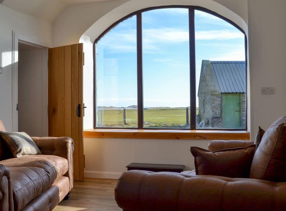 Light and airy living room at Cata Sand Cottage in Sanday, Orkney, Isle Of Orkney