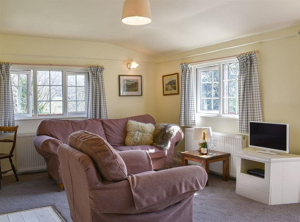 Living area at Cedar Lodge in Llanfair Talhairarn, near Abergele, Conwy, Clwyd