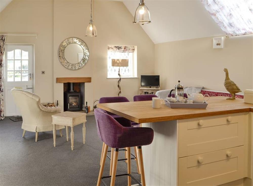 Delightful open-plan living space at The Coach House,