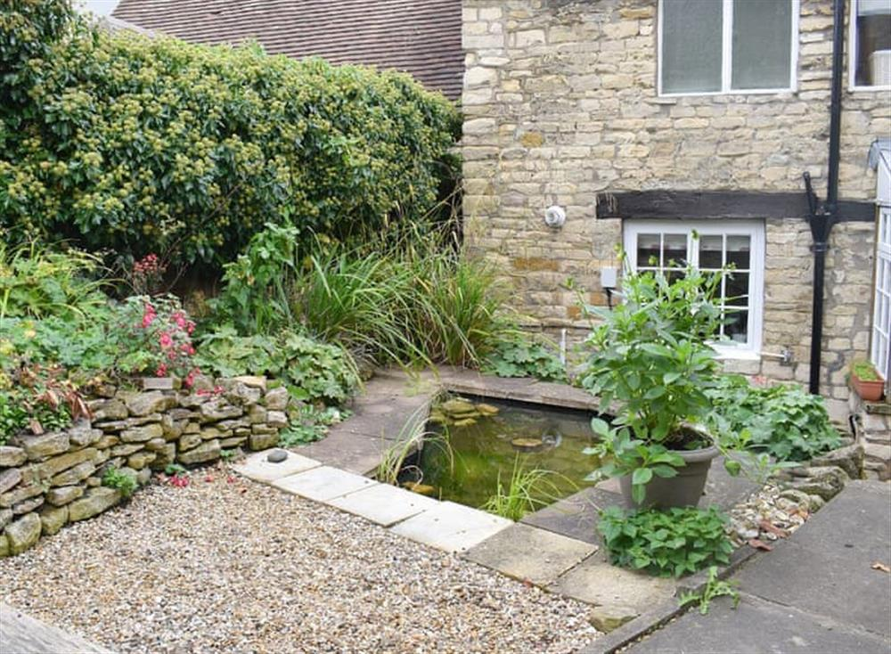 Patio area with unfenced ornamental pond