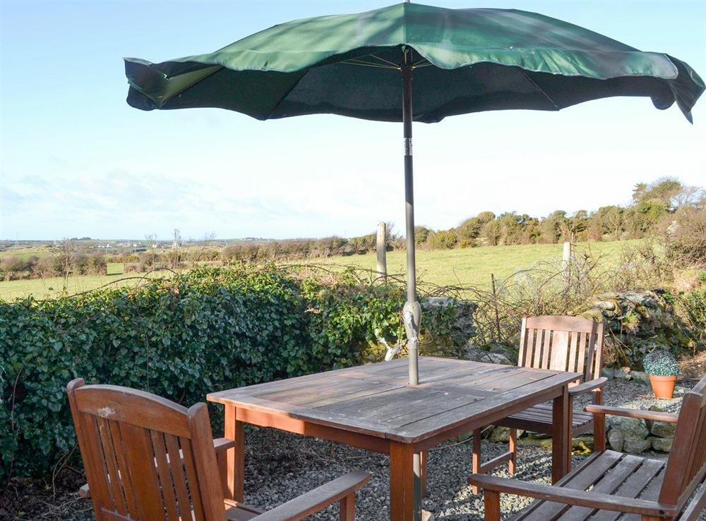 Gravelled patio area with outdoor furniture