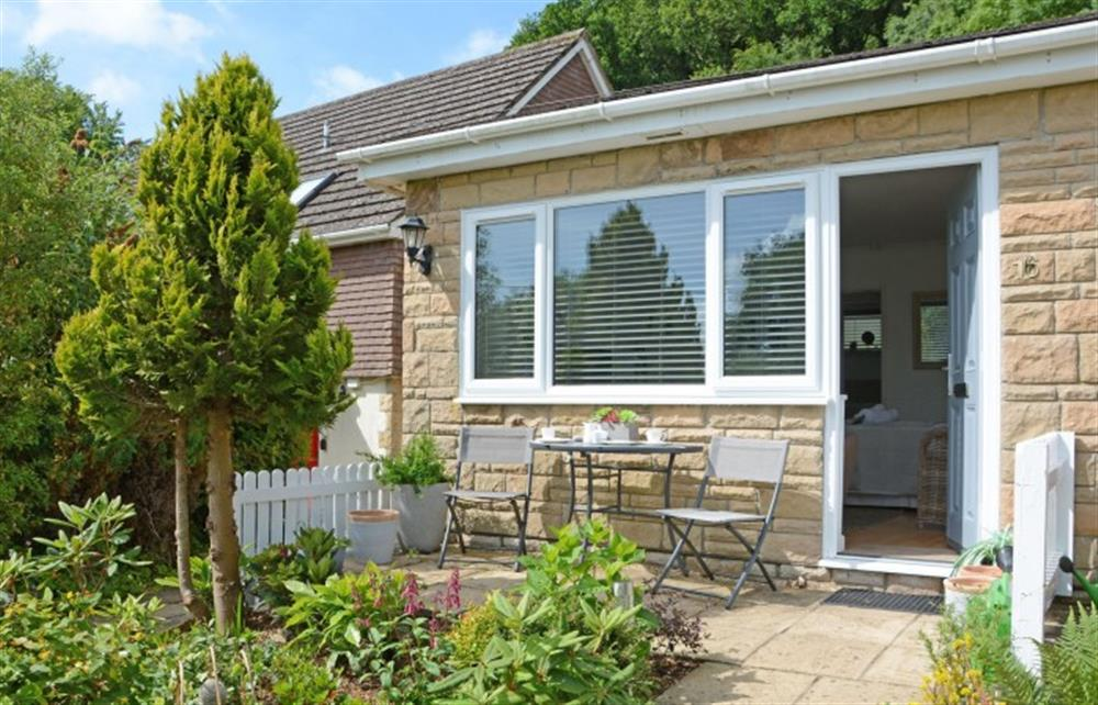 Patio area with seating at the front of the property at Char Heights, Charmouth