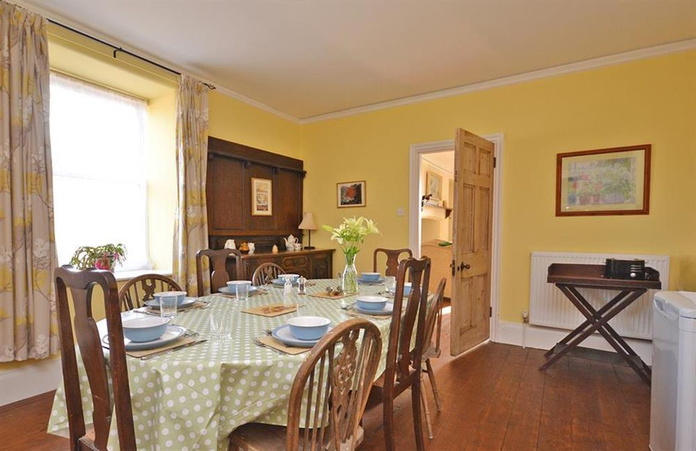 The dining table comfortably seats eight guests at Charford Manor, Diptford