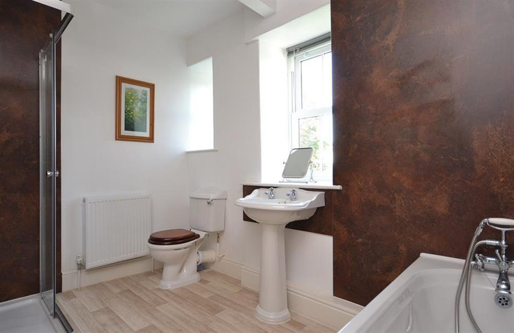 The family bathroom with bath and separate shower.   at Charford Manor, Diptford