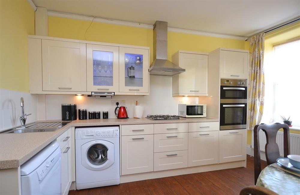 The kitchen is modern and fully equipped at Charford Manor, Diptford