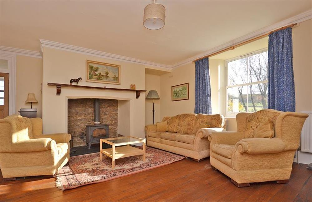 The second lounge, also with a wood burning stove at Charford Manor, Diptford