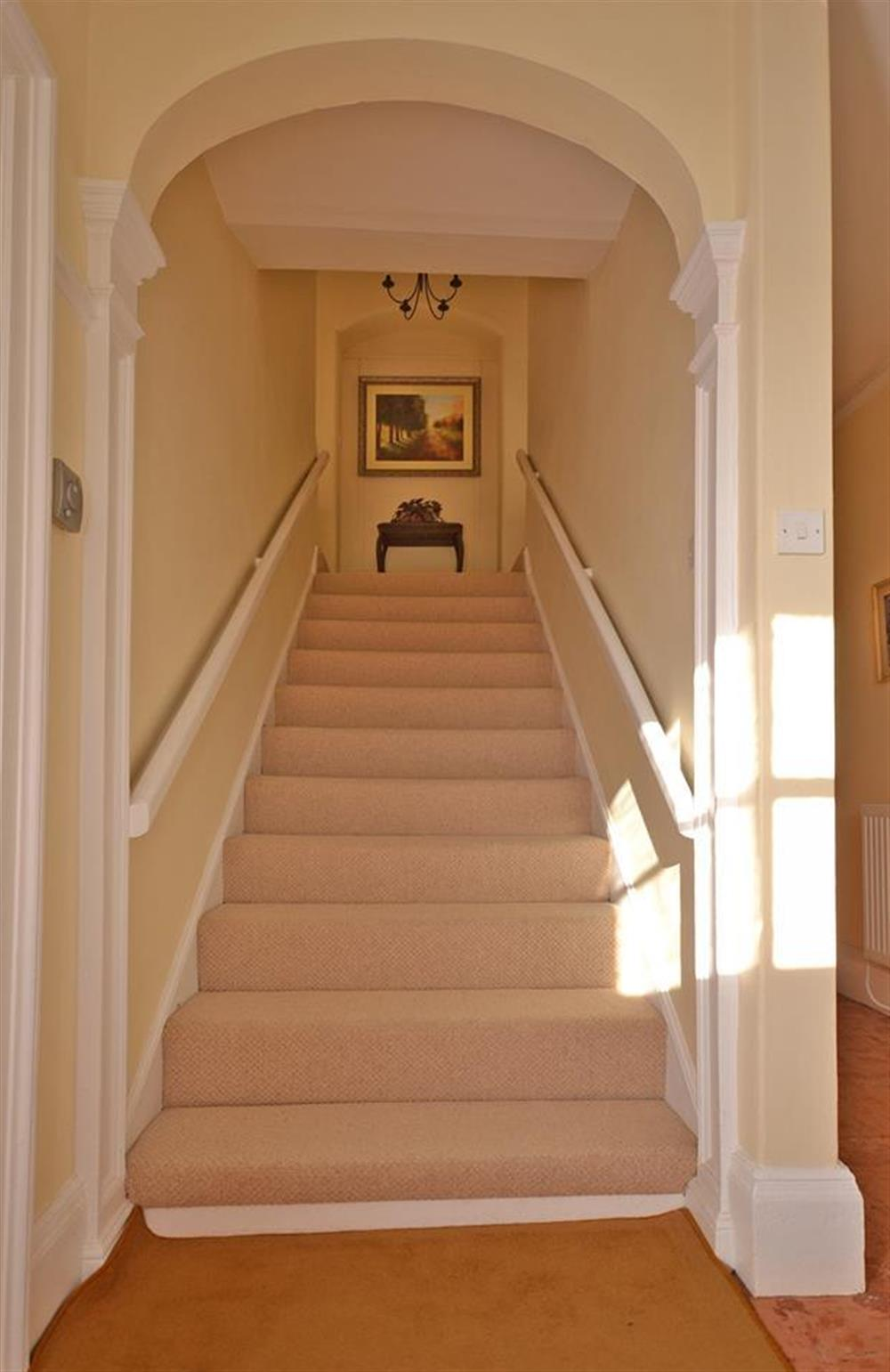 The wide staircase leading up to the first floor at Charford Manor, Diptford