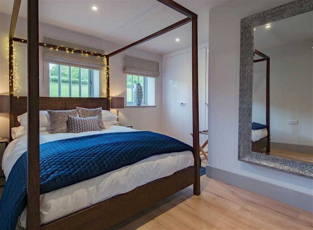 Four Poster bedroom at Cherry Tree Cottage at Frame Farm in Benenden, England