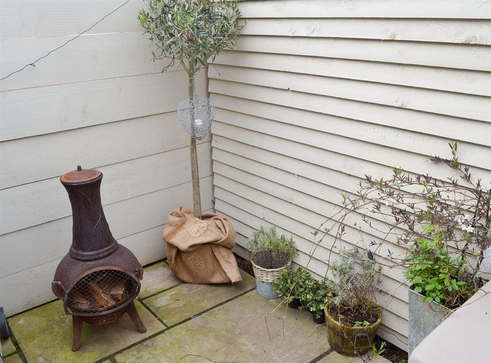 Enclosed courtyard with sitting-out-area, barbeque and chimenea at The Nest,