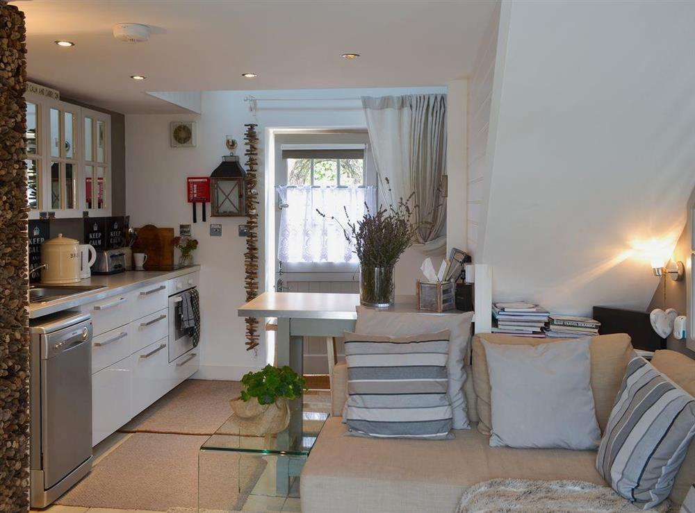 Kitchen with breakfast bar at The Nest,