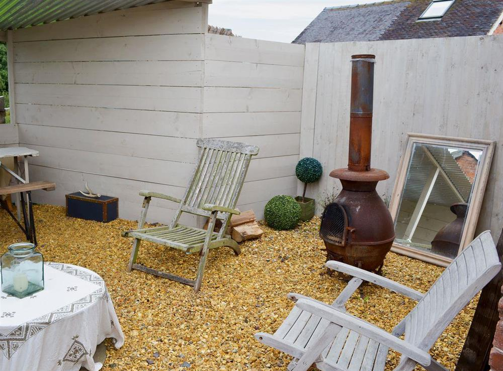 Courtyard with garden furniture, barbeque and chiminea (photo 2) at The Old Parlour,
