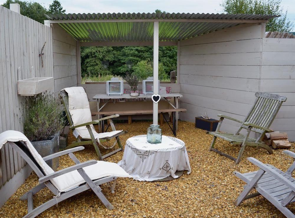 Courtyard with garden furniture, barbeque and chiminea at The Old Parlour,