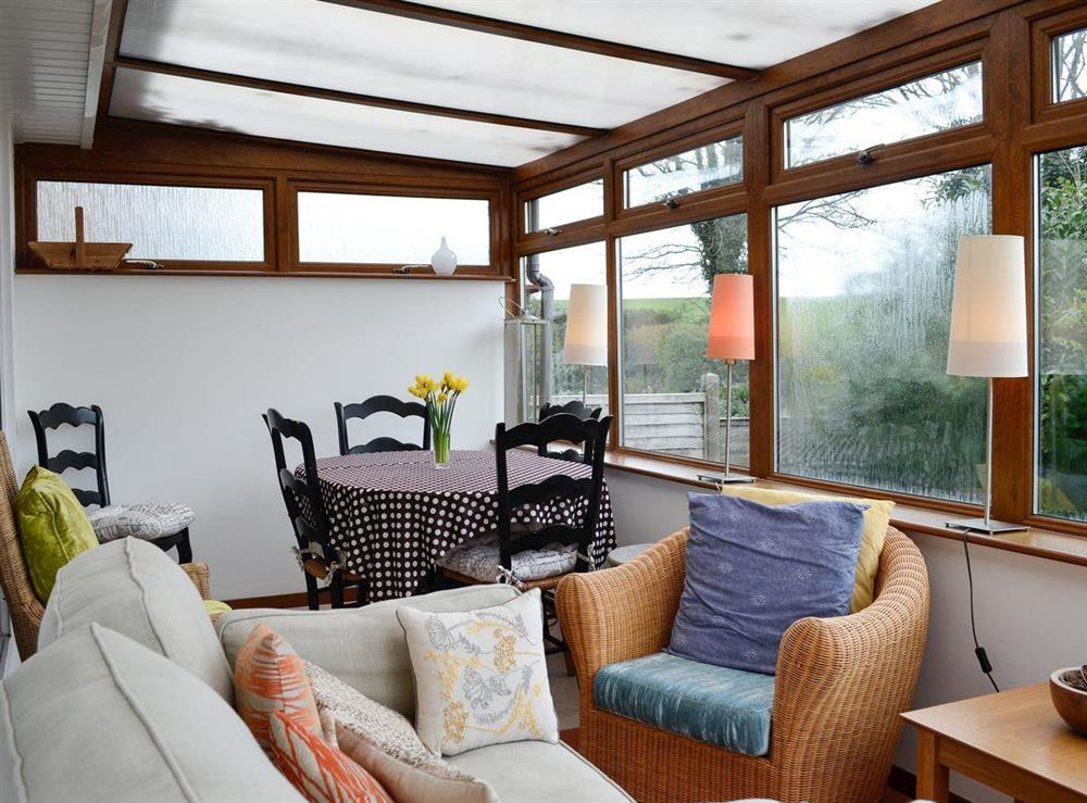 Conservatory with additional dining area at Chez Nous in Brixham, Devon, England