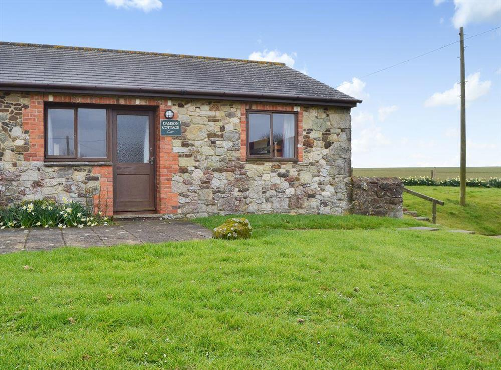 Lovely holiday cottage set in a courtyard at Damson Cottage,