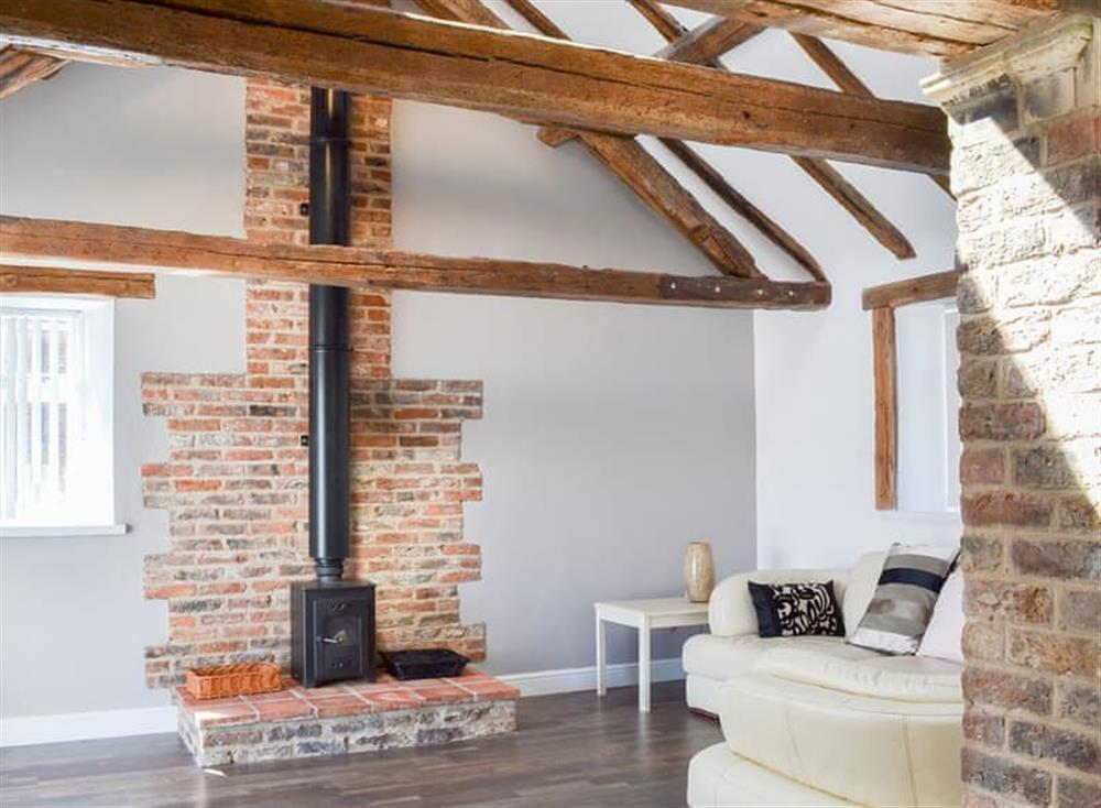 Welcoming and cosy living room at Christine Cottage in Flamborough, North Humberside