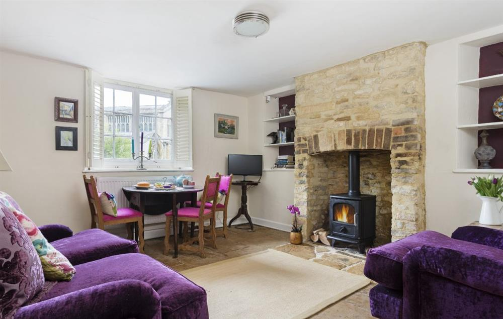 Ground floor: Sitting room with wood burning stove and dining area at Church Cottage, Chipping Norton