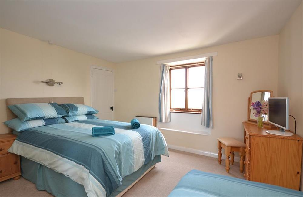 Bedroom 2 with a double bed, single bed and walk-in wardrobe at Churchgate House, Blackawton