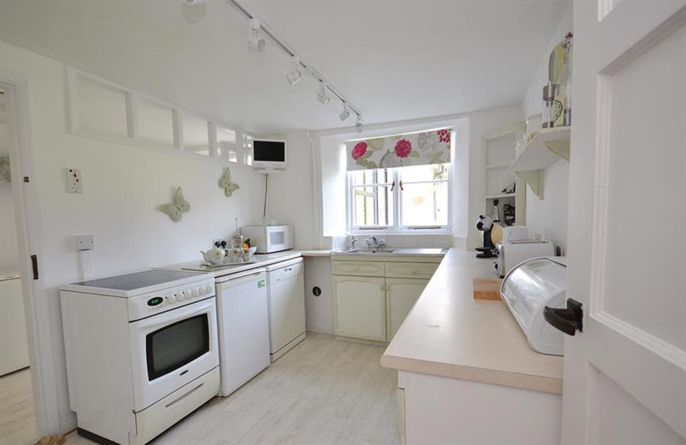 The kitchen looks out over the garden at Churchgate House, Blackawton