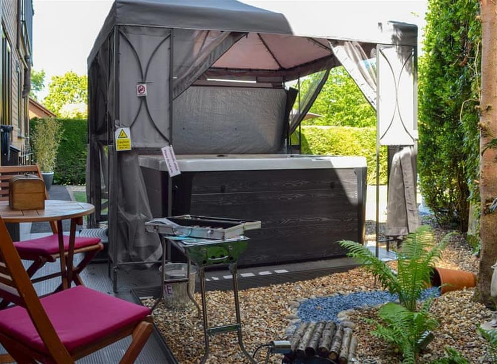 Outdoor area with hot tub at Churnet Reach in Cheddleton, near Leek, Staffordshire