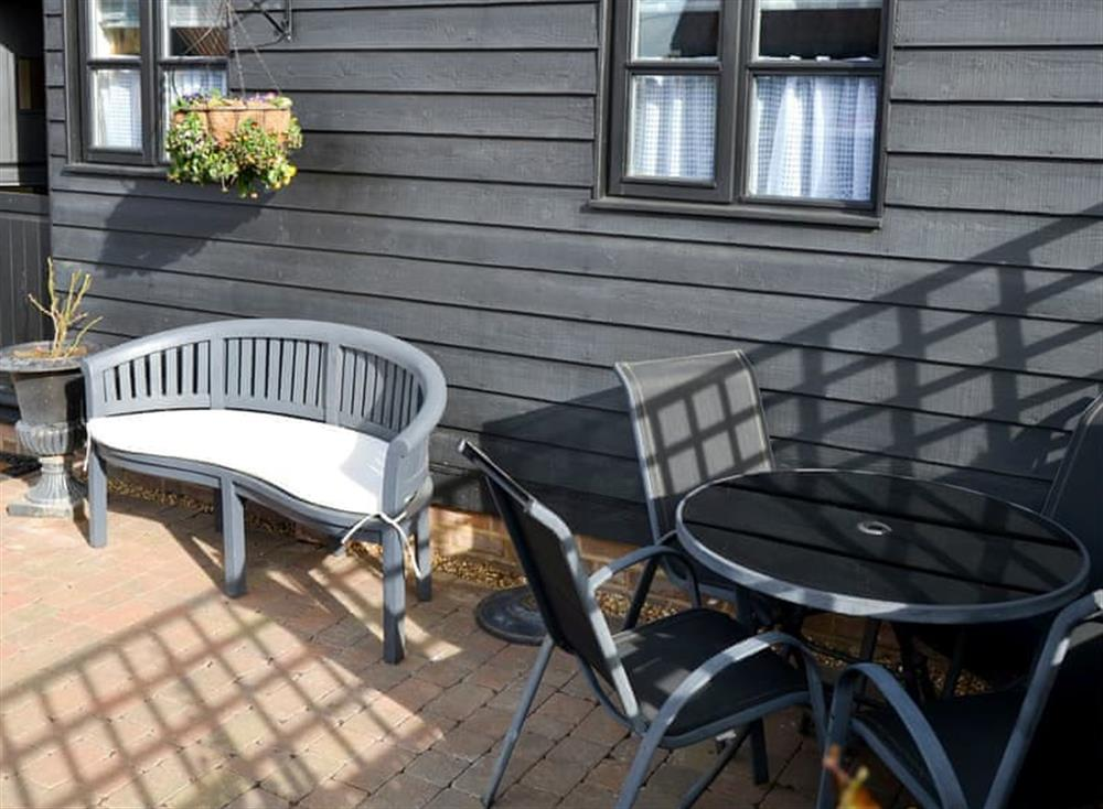 Enclosed courtyard with garden furniture at Clamp Farm Barn 2 in Stowmarket, Suffolk