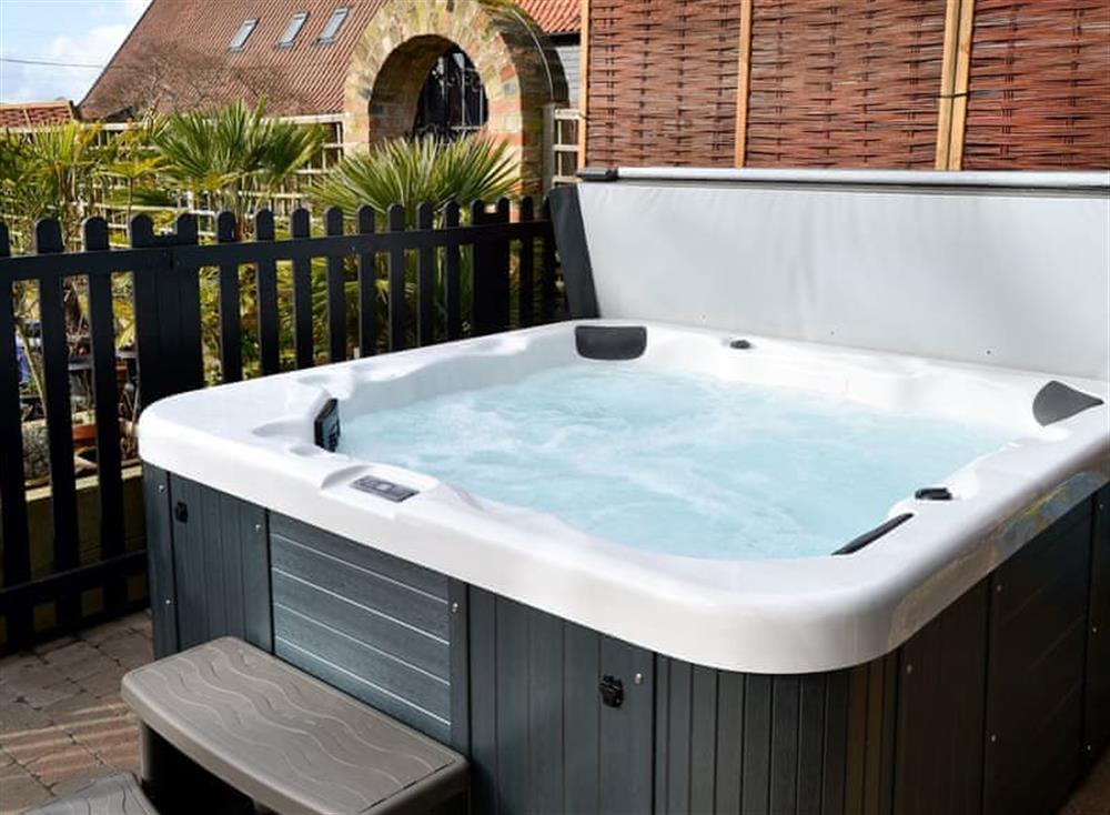 Private hot tub for 4 at Clamp Farm Barn 2 in Stowmarket, Suffolk
