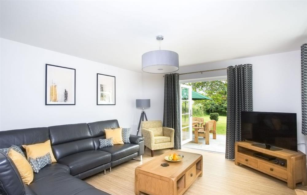 Ground floor: Sitting room with french doors leading to patio