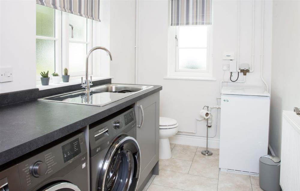 Ground floor: Utility room with WC
