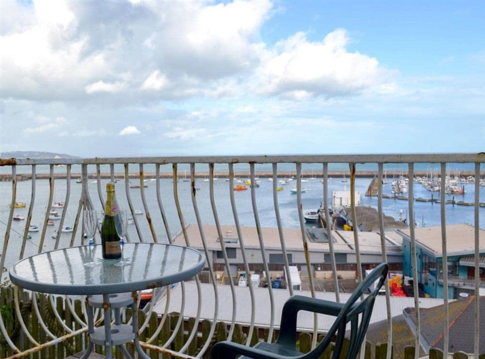 Balcony with harbour views at Cliff Cottage in Brixham, Devon