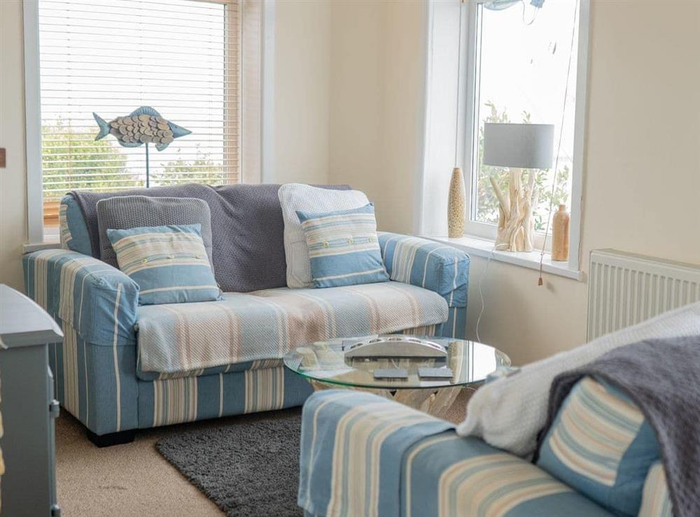 Bright and airy living room at Cliff Cottage in Brixham, Devon