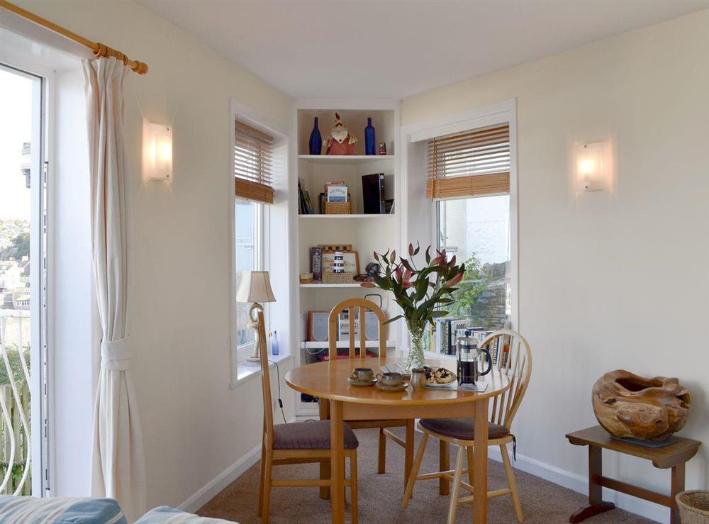 Charming dining area at Cliff Cottage in Brixham, Devon