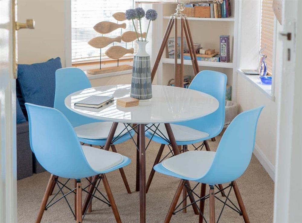 Delightful dining area at Cliff Cottage in Brixham, Devon
