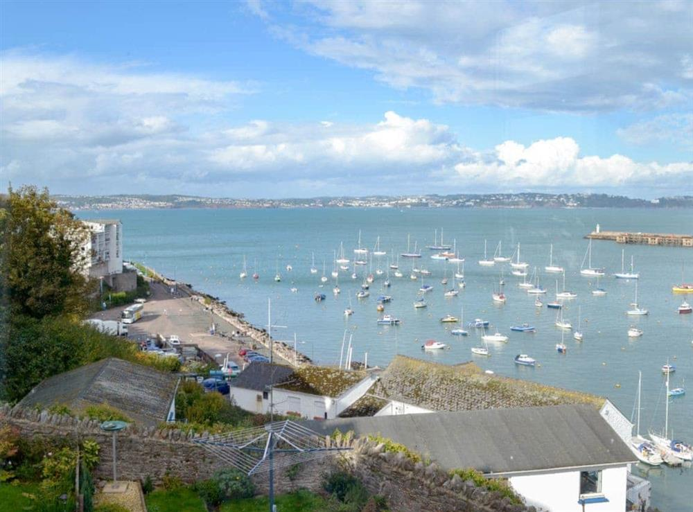 Far reaching sea views from the bedroom at Cliff Cottage in Brixham, Devon