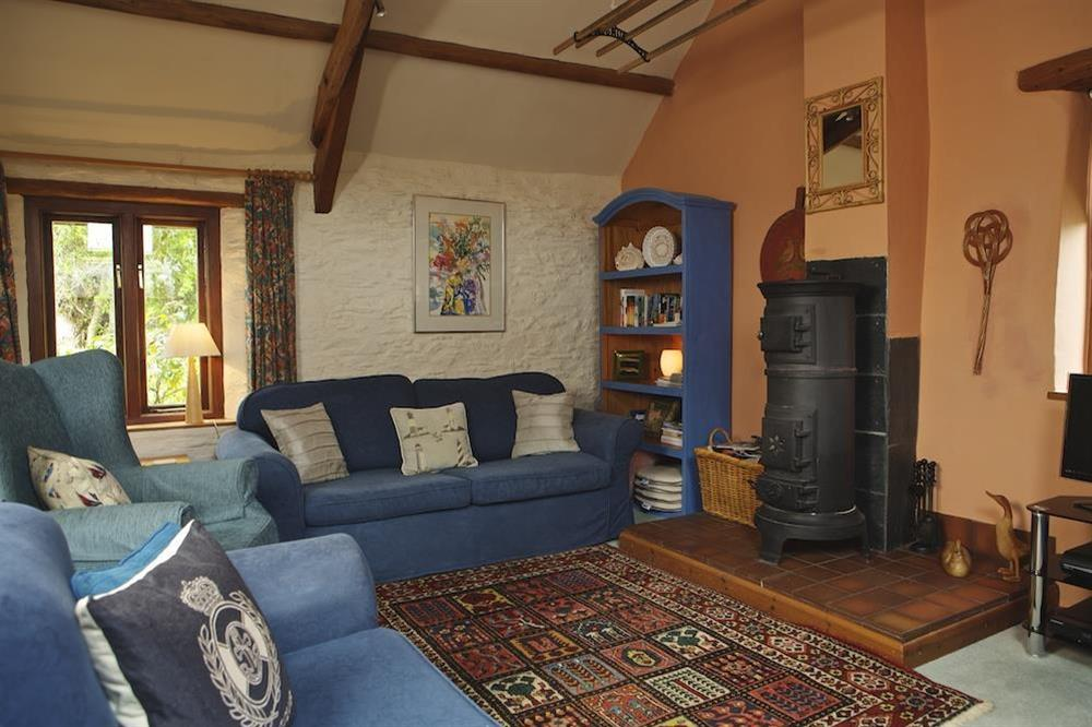 Comfortable lounge with Lange woodburner (photo 2) at Clover in Blackawton, Dartmouth