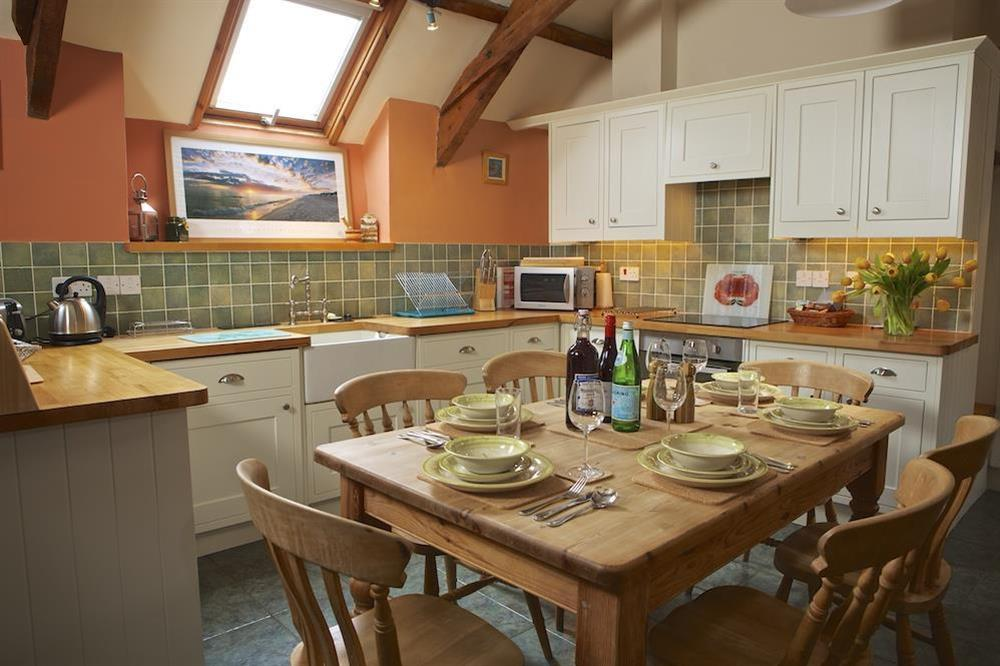 Kitchen with dining table at Clover in Blackawton, Dartmouth