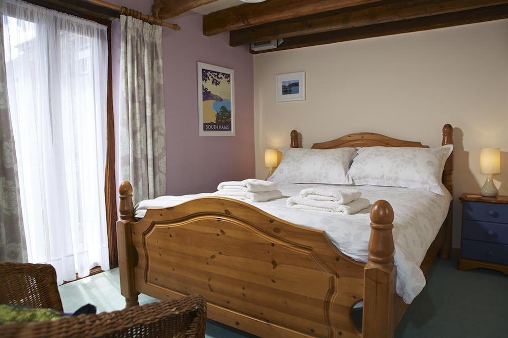 Master bedroom with double bed at Clover in Blackawton, Dartmouth