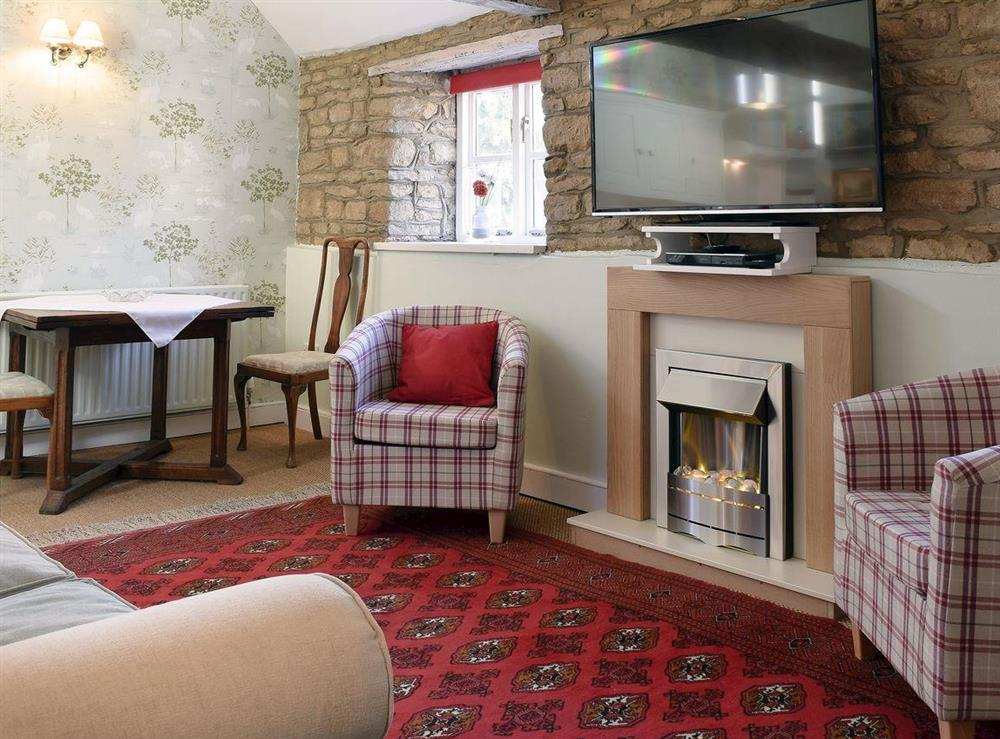 Charming and cosy open plan living space at Coach Cottage in Water Newton, near Peterborough, Cambridgeshire