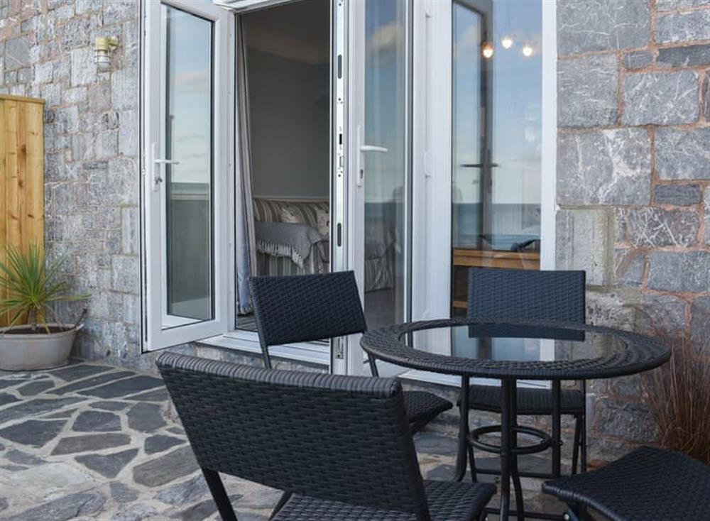 Charming balcony area with table and chairs