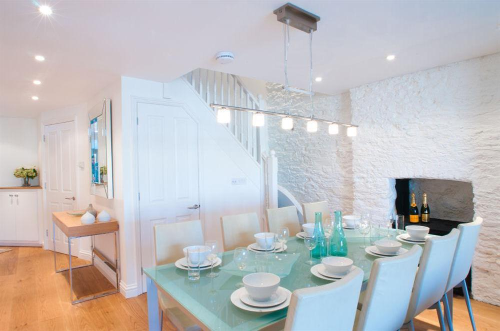 Large glass-topped dining table seating 6 comfortably (photo 2) at Cobbs Cottage in 20 Crowthers Hill, Dartmouth
