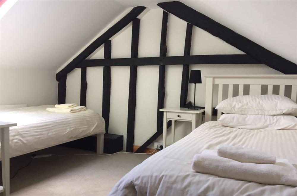 Twin bedroom with en suite w.c (second floor) at Cobbs Cottage in 20 Crowthers Hill, Dartmouth