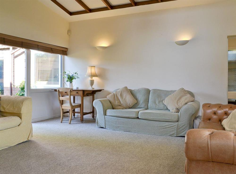 Comfy seating in living room at Cobden House in Lakenheath, near Brandon, Suffolk